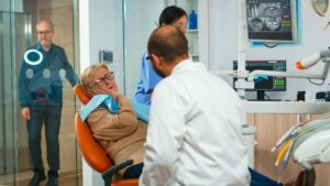 woman with dental emergency toothache talking with dentist